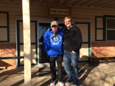 Freddy and Brent in front of Freddy Cobb Lodge